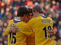 Photo: Glyn Thomas.<br />Charlton Athletic v Arsenal. The Barclays Premiership.<br />26/12/2005.<br />Arsenal's Jose Antonio Reyes (C) celebrates after giving his team a 1-0 lead with Alexander Hleb (R) and Cesc Fabregas.