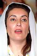Prime Minister Benazir Bhutto and leader of the Pakistan People's Party speaks to supporters on the eve of national elections from her home district October 24, 1990 in Larkana, Pakistan.