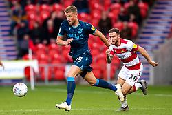 Alfie Kilgour of Bristol Rovers takes on Jon Taylor of Doncaster Rovers - Mandatory by-line: Robbie Stephenson/JMP - 19/10/2019 - FOOTBALL - The Keepmoat Stadium - Doncaster, England - Doncaster Rovers v Bristol Rovers - Sky Bet League One