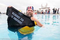 Thomas Lackey of Orange, TX jumped into the pool to get a shirt that was cannoned into the crowd at the HOG (Harley Owners Group) party by the pool at the Full Throttle Saloon during the Sturgis Black Hills Motorcycle Rally. SD, USA. Thursday, August 8, 2019. Photography ©2019 Michael Lichter.