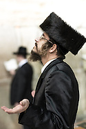 A Haredim in Shabbat close with traditional bekishe coat and shtreimel fur hat. The bekishe is a long coat usually made of black silk worn by Hasidic Jews, and by some non-Hasidic Haredi Jews.<br /> The bekishe is worn mainly on Shabbat and Jewish holidays, or at weddings and other such events. Shtreimel is a fur hat worn by many married haredi Jewish men on Shabbat. To Jewish law there is no special religious significance to the shtreimel as compared to other head coverings. However, the wearing of two head coverings is considered to add additional spiritual merit. The shtreimel is always worn over a kippah, or yarmulke.