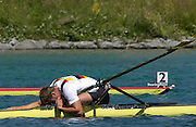 2005 FISA Rowing World Cup Munich,GERMANY. 19.06.2005; GER M1X Marcel Hacker collapses after winning the final. Photo  Peter Spurrier. .email images@intersport-images.[Mandatory Credit Peter Spurrier/ Intersport Images] Rowing Course, Olympic Regatta Rowing Course, Munich, GERMANY