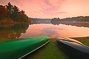 canoes on beach at George Lake at dawn<br />Killarney Provincial Park<br />Ontario<br />Canada