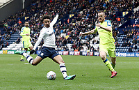 Preston North End's Callum Robinson shoots from close-range despite the attentions of Derby County's Alex Pearce<br /> <br /> Photographer Rich Linley/CameraSport<br /> <br /> The EFL Sky Bet Championship - Preston North End v Derby County - Monday 2nd April 2018 - Deepdale Stadium - Preston<br /> <br /> World Copyright © 2018 CameraSport. All rights reserved. 43 Linden Ave. Countesthorpe. Leicester. England. LE8 5PG - Tel: +44 (0) 116 277 4147 - admin@camerasport.com - www.camerasport.com
