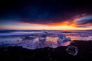 Sunset at the Black Sand Beach, Jökulsárlón, Iceland.