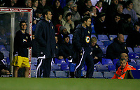Leeds management Gus Poyet (left) and Dennis Wise (right) watch the defeat to Birmingahm City