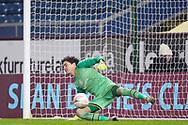 Milton Keynes Dons goalkeeper Lee Nicholls (1) fail to save Burnley midfielder Josh Benson (41) scoring a penalty during the FA Cup match between Burnley and Milton Keynes Dons at Turf Moor, Burnley, England on 9 January 2021.