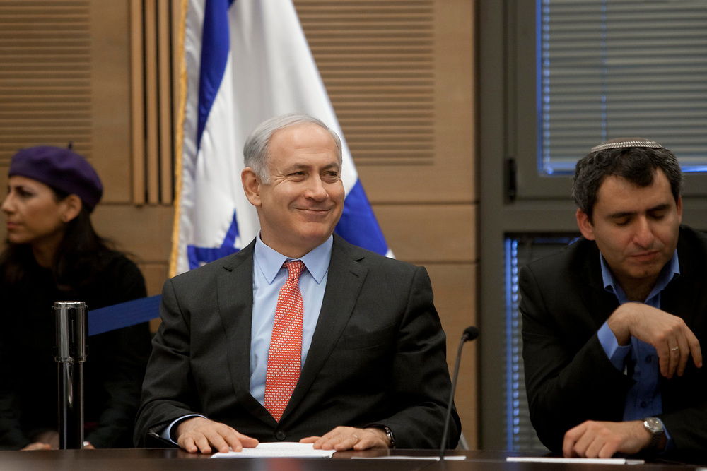 Israel's Prime Minister Benjamin Netanyahu (2nd L) and MK Ze'ev Elkin attend a Likud faction meeting at the Knesset, Israel's parliament in Jerusalem, on January 30, 2012.