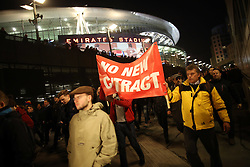 7 March 2017 - UEFA Champions League - (Round of 16) - Arsenal v Bayern Munich - Arsenal fans pass the Emirates stadium as they march in protest at Arsene Wenger - Photo: Mark Leech / Offside.