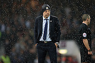 West Ham United manager Slaven Bilic looks on from the touchline in the rain.  The Emirates FA cup, 6th round replay match, West Ham Utd v Manchester Utd at the Boleyn Ground, Upton Park  in London on Wednesday 13th April 2016.<br /> pic by John Patrick Fletcher, Andrew Orchard sports photography.