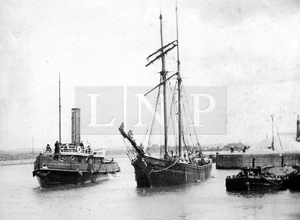 """© Licensed to London News Pictures. 30/09/2016. Birkenhead UK. Collect picture shows the Ralph Brocklebank (Daniel Adamson) in Ellesmere Port in the early 1900's. The Daniel Adamson steam boat has been bought back to operational service after a £5M restoration. The coal fired steam tug is the last surviving steam powered tug built on the Mersey and is believed to be the oldest operational Mersey built ship in the world. The """"Danny"""" (originally named the Ralph Brocklebank) was built at Camel Laird ship yard in Birkenhead & launched in 1903. She worked the canal's & carried passengers across the Mersey & during WW1 had a stint working for the Royal Navy in Liverpool. The """"Danny"""" was refitted in the 30's in an art deco style. Withdrawn from service in 1984 by 2014 she was due for scrapping until Mersey tug skipper Dan Cross bought her for £1 and the campaign to save her was underway. Photo credit: Andrew McCaren/LNP"""