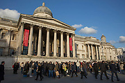 Large crowds gather outside The National Gallery to watch a street performer on the 11th December 2018 in London in the United Kingdom. The National Gallery is an art museum in the City of Westminster, in Central London. It was Founded in 1824 and houses a collection of over 2,300 paintings dating from the mid-13th century to 1900.