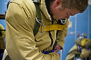 Smokejumper Brian Austin prepares for a training jump at McCall smokejumper base in McCall, ID.