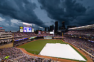 Storm clouds brew over Target Field before a game between the Minnesota Twins and Milwaukee Brewers on July 1, 2011 in Minneapolis, Minnesota.  The game was delayed for 2 hours until the storm passed.