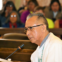 Navajo Nation Council Delegate Rickie Nez, who represents the chapters of T'iistoh Sikaad, Nenahnezad, Upper Fruitland, Tse' Daa' Kaan, Newcomb, and San Juan, debates legislation during the Navajo Nation Council Naabik'iyati Committee meeting Thursday in the Council chambers in Window Rock, Arizona.