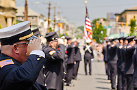 Local volunteer firemen, with an accompaniment from the bag pipers, pay tribute to the fallen and in particular the two young men from town that paid the ultimate price within the past two years.