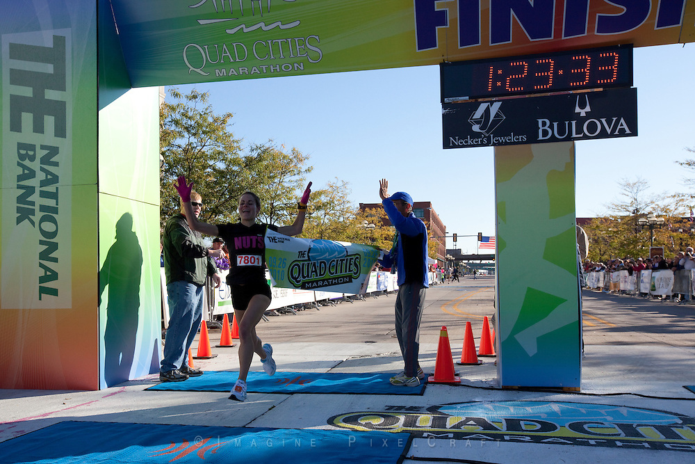 Another great photo of a winning athlete, Krista Vrombaut at the Quad Cities Marathon.