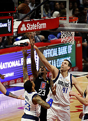February 25, 2019 - Los Angeles, California, U.S - Los Angeles Clippers' Lou Williams (23) goes to basket  while defended by Dallas Mavericks' Dirk Nowitzki (41) and Dallas Mavericks' Trey Burke (23) during an NBA basketball game between Los Angeles Clippers and Dallas Mavericks Monday, Feb. 25, 2019, in Los Angeles. (Credit Image: © Ringo Chiu/ZUMA Wire)