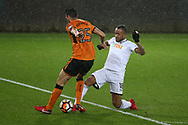 Jordan Ayew of Swansea city is tackled by Roderick Miranda of Wolverhampton Wanderers. The Emirates FA Cup, 3rd round replay match, Swansea city v Wolverhampton Wanderers at the Liberty Stadium in Swansea, South Wales on Wednesday 17th January 2018.<br /> pic by  Andrew Orchard, Andrew Orchard sports photography.