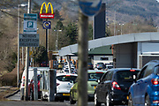MERTHYR TYDFIL, WALES - 23 March 2020: Cars queue at the McDonalds drive through, Merthyr Tydfil Retail park after it was announced the closer of all their UK stores at 7pm on the 23rd of March to help reduce the spread of coronavirus / Covid-19.
