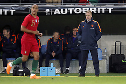 (L-R) Joao Mario of Portugal, assistant trainer Kees van Wonderen of Holland, assistant trainer Dwight Lodeweges of Holland, coach Ronald Koeman of Holland during the International friendly match match between Portugal and The Netherlands at Stade de Genève on March 26, 2018 in Geneva, Switzerland