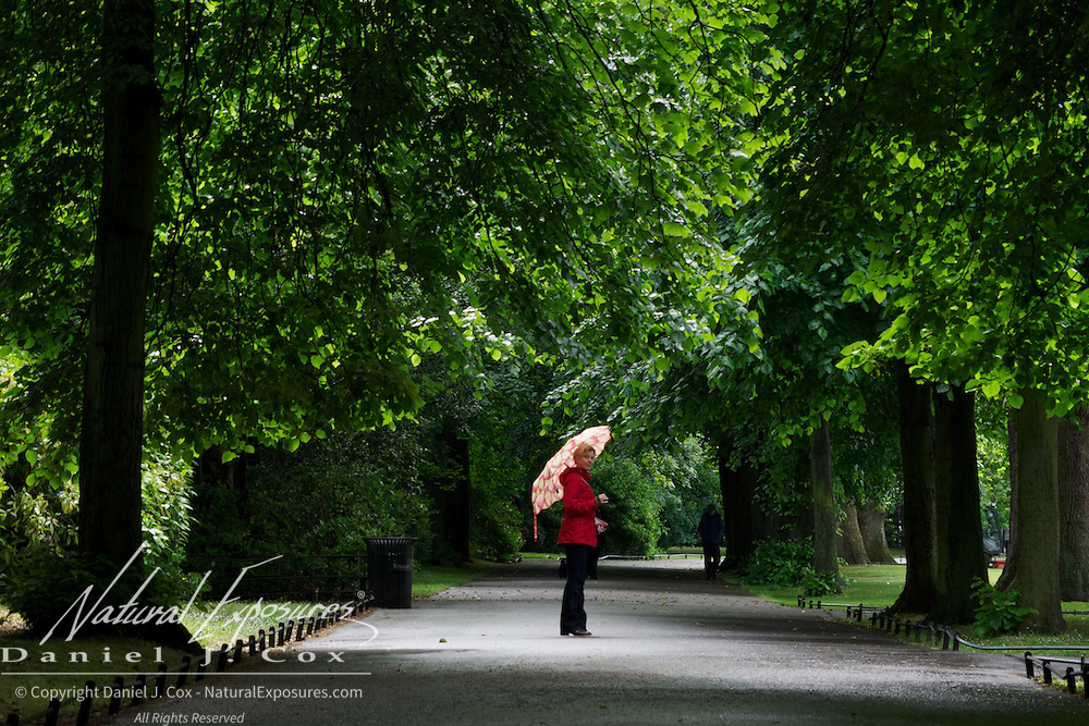 Tanya poses with her colorful umbrella in Saint Stephen's Green Park in Dublin, Ireland.