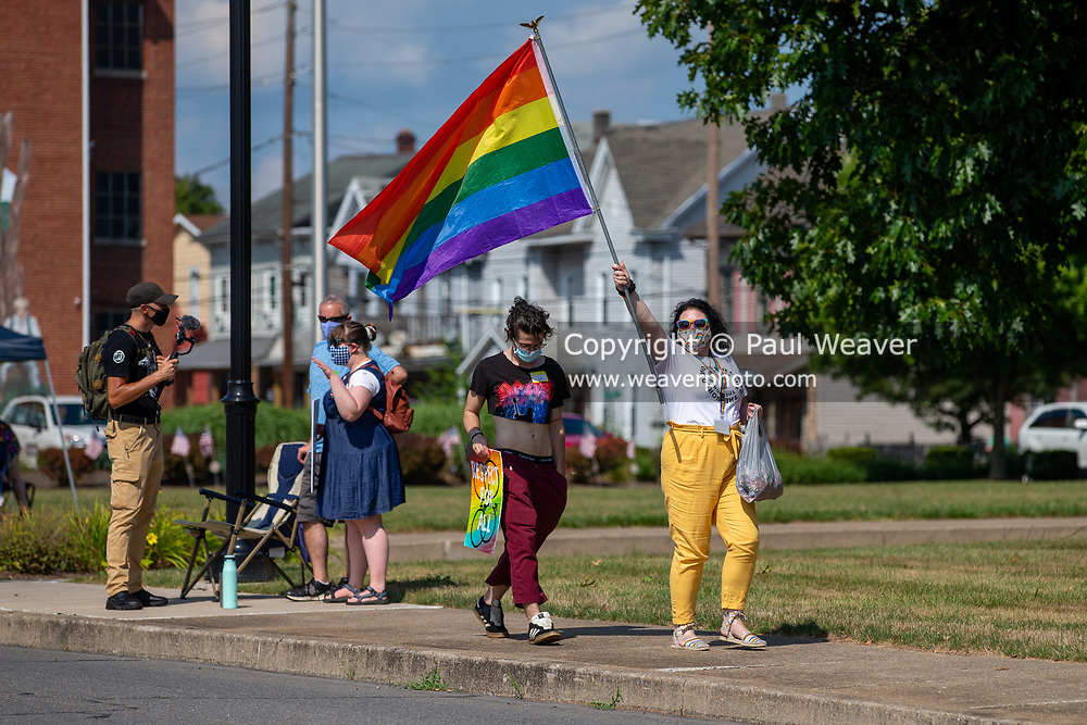 Victoria Mathews, founder of The I Am Alliance, waves a pride flag during the Milton Pride Rally in Milton, Pennsylvania on August 8, 2020. The I Am Alliance organized the event to show support for the LGBTQ community.