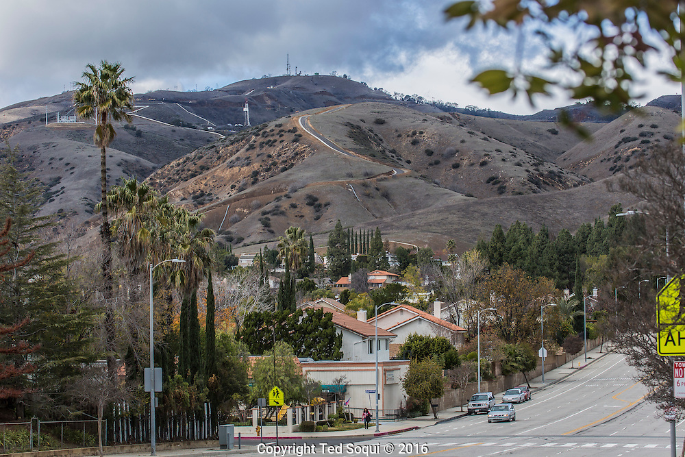 Evacuated homes and a deserted street directly below the gas leak.<br /> California Gov. Jerry Brown declared a state of emergency in the Porter Ranch area of Los Angeles due to the continuing leak of natural gas from the Aliso Canyon storage facility. Natural gas has been leaking since October 23, 2015 in the community. Over 2000 residents have been evacuated from their homes along with two schools that are closed due to the leak. More residents are expected to be evacuated from the bedroom community. The leak is estimated to be capped in late February or March of this year.