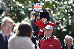 © Licensed to London News Pictures. 20/04/2016. A young boy dressed in a bearskin and military uniform waves the union flag as he watches Queen Elizabeth II officially open the new bandstand at Alexandra Gardens in Windosr on the eve of her 90th birthday. Photo credit: Hannah McKay/LNP