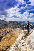 Climber on Cathedral Peak, Tuolumne Meadows area, Yosemite National Park, California USA