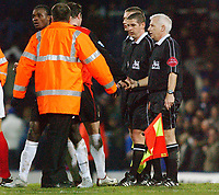Fotball<br /> England 2004/22005<br /> Foto: SBI/Digitalsport<br /> NORWAY ONLY<br /> <br /> Portsmouth v Blackburn Rovers<br /> 15/1/2005<br /> Barclays Premiership<br /> <br /> Referee Andy D'Urso and his linesmen get a escort off the pitch at the of game.