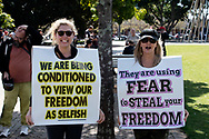 SYDNEY, NSW - SEPTEMBER 05: Two women pose holding up signs  during the Freedom Day Rally on September 05, 2020 in Sydney, Australia. Protesters argue COVID-19 is a hoax and say their freedoms are being unfairly impinged. Demonstrations are also taking place in every Australian capital city and several regional areas, including Byron Bay. (Photo by Lucca Markham/Speed Media)