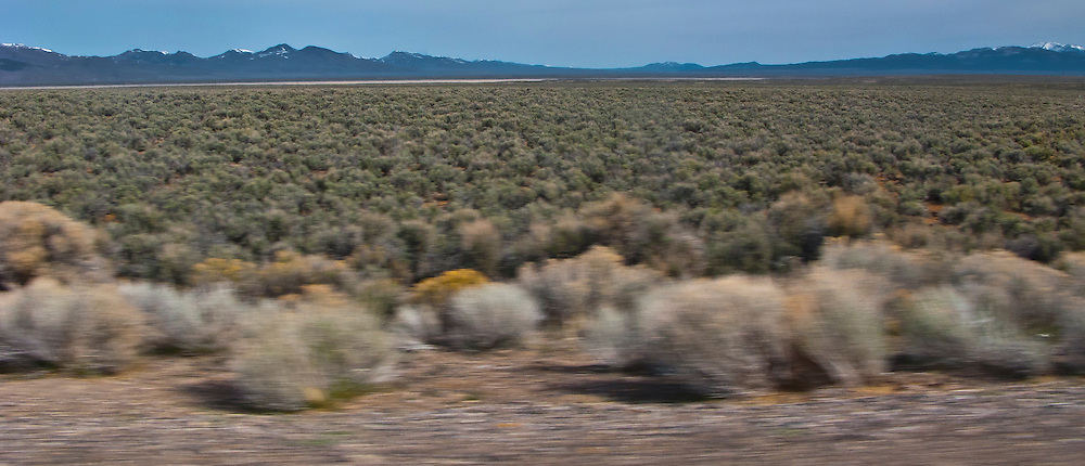 sagebrush covers a high desert broad valley ringed by mountains in central Nevada panorama US 50 loneliest road in America