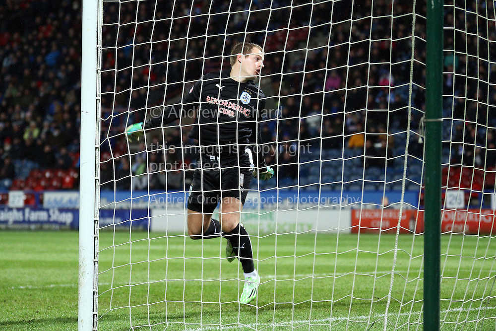 Huddersfield Town Goalkeeper Alex Smithies can only watch as the ball hits the back of his net for Birmingham's goal scored by  David Cotterill (not in pic). Skybet football league championship match, Huddersfield Town v Birmingham city at the John Smith's stadium in Huddersfield, Yorkshire on Saturday 20th December 2014.<br /> pic by Chris Stading, Andrew Orchard sports photography.