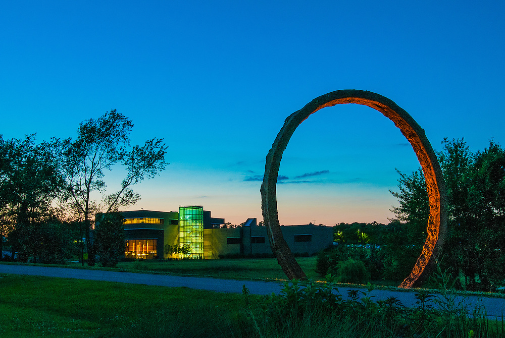 """The North Carolina Museum of Art at dusk in June of 2012, featuring one of Thomas Sayre's """"Gyre"""" rings in the foreground.  """"Gyre"""" is a copyrighted work of Thomas Sayre."""