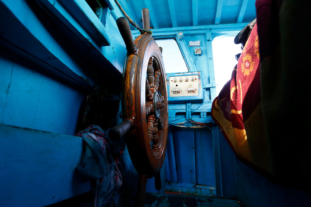 The helm of a wooden boat used by migrants is seen after a rescue operation 10.5 miles (16 kilometres) off the coast of Libya August 6, 2015.  An estimated 600 migrants on the boat were rescued by the international non-governmental organisations Medecins san Frontiere (MSF) and the Migrant Offshore Aid Station (MOAS) without loss of life on Thursday afternoon, according to MSF and MOAS, a day after more than 200 migrants are feared to have drowned in the latest Mediterranean boat tragedy after rescuers saved over 370 people from a capsized boat thought to be carrying 600.<br /> REUTERS/Darrin Zammit Lupi <br /> MALTA OUT. NO COMMERCIAL OR EDITORIAL SALES IN MALTA