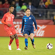 EAST HARTFORD, CONNECTICUT- October 16th:   Nilson Loyola #22 of Peru challenged by midfielder Marky Delgado #8 of the United States during the United States Vs Peru International Friendly soccer match at Pratt & Whitney Stadium, Rentschler Field on October 16th 2018 in East Hartford, Connecticut. (Photo by Tim Clayton/Corbis via Getty Images)