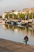 Fisherman by river in Verdun, France