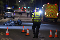 © Licensed to London News Pictures. 06/09/2021. High Wycombe, UK. A police officer stands in front of a motorbike at the scene in High Wycombe following a fatal road traffic collision involving a car and a motorbike. Emergency services, including an air ambulance, were called to the scene at approximately 20:15BST to the corner of London Road (A40) and Hammersley Lane. The motorcyclist died at the scene. A large section of London Road between Station Road and Gomm Road was closed for several hours as police conducted an investigation into the collision. Photo credit: Peter Manning/LNP