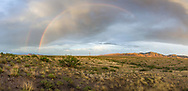 A double rainbow visible to the east as sun sets on the high desert of SE Arizona (panorama)