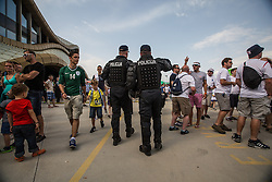 Police force walks through fans before the EURO 2016 Qualifier Group E match between Slovenia and England at SRC Stozice on June 14, 2015 in Ljubljana, Slovenia. Photo by Grega Valancic