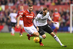 February 25, 2019 - Nottingham, England, United Kingdom - Derby County defender Richard Keogh (6) with Daryl Murphy (9) of Nottingham Forest looking to intercept during the Sky Bet Championship match between Nottingham Forest and Derby County at the City Ground, Nottingham on Monday 25th February 2019. (Credit Image: © Mi News/NurPhoto via ZUMA Press)