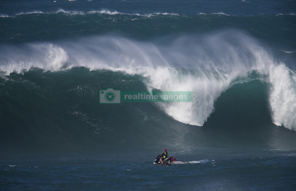 December 13, 2017 - Waimea Bay, HI, USA - WAIMEA BAY, HI - DECEMBER 13, 2017 - A lifeguard patrols the surf at Waimea Bay where 18-22 ft waves were breaking Wednesday. The big wave surfing spot only breaks in the winter when storms send large north swells toward the North Shore of Oahu. (Credit Image: © Erich Schlegel via ZUMA Wire)