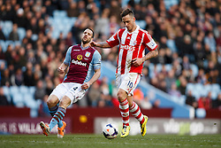 Stoke Forward Marko Arnautovic (AUT) is challenged by Aston Villa Defender Ron Vlaar (NED) - Photo mandatory by-line: Rogan Thomson/JMP - 07966 386802 - 23/03/2014 - SPORT - FOOTBALL - Villa Park, Birmingham - Aston Villa v Stoke City - Barclays Premier League.
