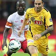 Galatasaray's Dany Achille (L) and Eskisehirspor's Necati Ates (R) during their Turkish Super League soccer match Galatasaray between Eskisehirspor at the TT Arena at Seyrantepe in Istanbul Turkey on Saturday, 06 October 2012. Photo by TURKPIX