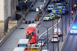 © Licensed to London News Pictures. 29/11/2019. London, UK.  A body, believed to be attacker Usman Khan, lies on the ground as a police photographer records the scene following a suspected terror attack on London Bridge. Several people were stabbed, at least two fatally, before armed police shot the attacker dead.  Photo credit: Cliff Hide/LNP