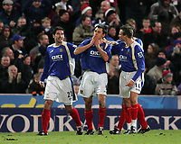 Photo: Lee Earle.<br /> Portsmouth v West Bromwich Albion. The Barclays Premiership. 17/12/2005. Portsmouth's Svetoslav Todorov (C) is congratulated by Richard Hughes (L)and Matthew Taylor (R) after scoring their opening goal.