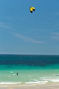 Windsurfer on beach in Cala del Varadero, Spain