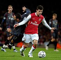 Photo: Ed Godden.<br /> Arsenal v CSKA Moscow. UEFA Champions League, Group G. 01/11/2006. Arsenal's Cesc Fabregas (L) fouls CSKA Moscow's Daniel Carvalho.