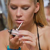 Participant ajusts her makeup during the Miss Bikini Hungary beauty contest held in Budapest, Hungary on August 06, 2011. ATTILA VOLGYI